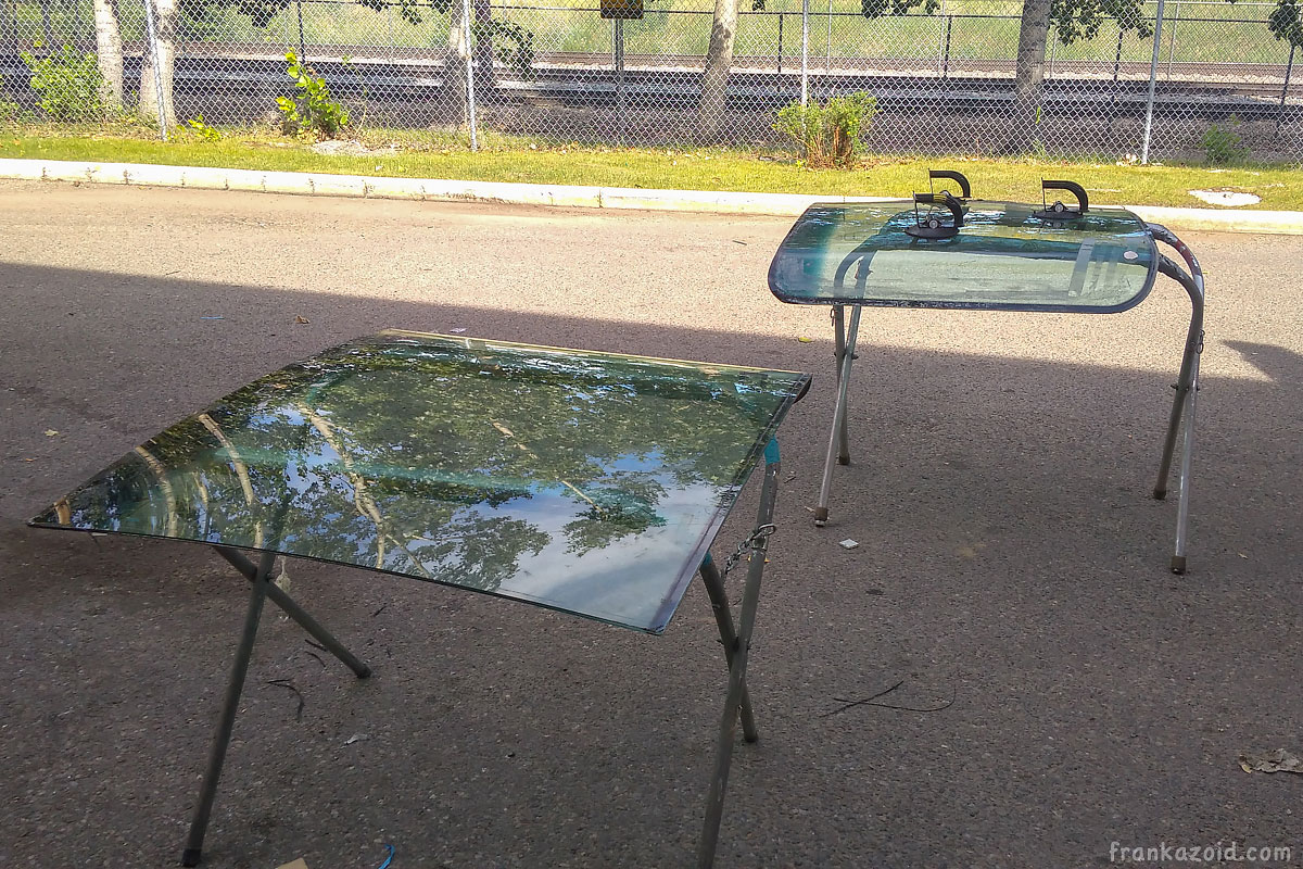 Windshields laying on two stands